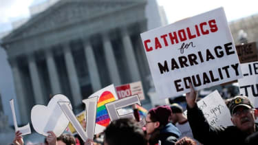 Equal rights supporters demonstrate outside the Supreme Court on March 26