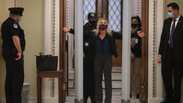 Rep. Marjorie Taylor Greene goes through the Capitol's new metal detector.