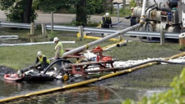 Workers clean up a massive oil spill in Michigan in July 2010: Some researchers say a similar spill would be all but inevitable for Keystone XL.