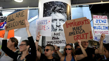 President Trump blamed protesters, like these at LAX, for the chaos caused by his executive order.