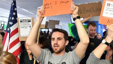 Iraq War veteran Evan Cohen protests at San Francisco Airport on Sunday.