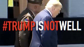 Donald Trump walks down a ramp.
