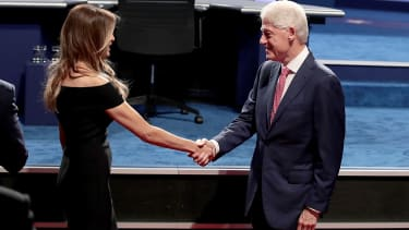 Melania Trump and Bill Clinton shakes hands before the second presidential debate.