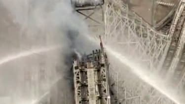 Watch a Six Flags roller coaster collapse in flames