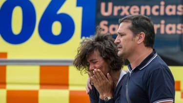 Relatives of passengers involved in Spain's deadly train crash wait for news on July 25, 2013 in Santiago de Compostela.