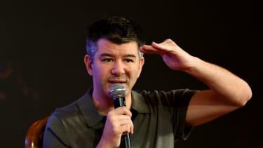 Uber CEO Travis Kalanick speaks to a crowd