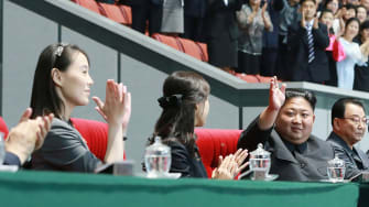 Kim Yo Jong, left, with her sister-in-law and brother Kim Jong Un.