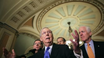 Senate Majority Leader Mitch McConnell  talks to reporters.