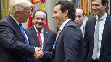 Donald Trump meets with auto industry executives.