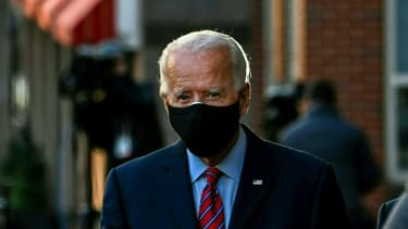 Biden walks with a mask on