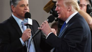 Fox News Channel and radio talk show host Sean Hannity (L) interviews U.S. President Donald Trump before a campaign rally at the Las Vegas Convention Center on September 20, 2018 in Las Vegas