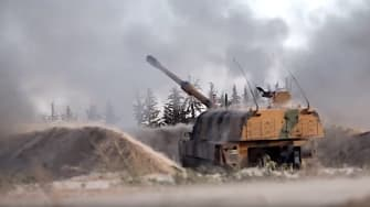 Turkish tanks fire on Syria