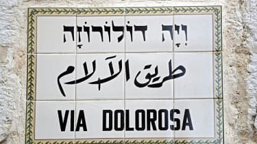 A street sign in Arabic and Hebrew.