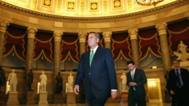 House Speaker John Boehner walks to the House Chamber to oversee the New Year's Day fiscal-cliff vote.