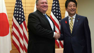 Secretary of State Mike Pompeo (L) shakes hands with Japan's Prime Minister Shinzo Abe