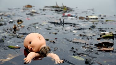 Pollution floats in Rio's Guanabara Bay, the site of the Olympic sailing event, in July 2015.
