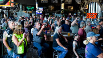 People watch a concert at the Full Throttle Saloon during the 80th Annual Sturgis Motorcycle Rally in Sturgis, South Dakota on August 9, 2020.