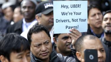 Uber drivers protest fare cuts.