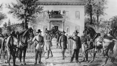 Confederate Gen. Robert E. Lee surrenders to Gen. Ulysses S. Grant at the Appomattox Court House.