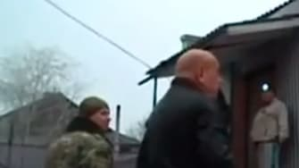 Locals look at damage in Debaltseve, Ukraine