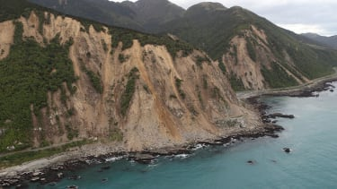 Huge slips, caused by the 7.5 earthquake, are seen blocking State Highway One north of Kaikoura on November 14, 2016 in New Zealand