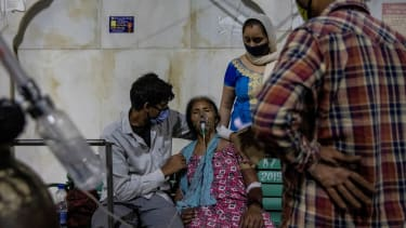 A COVID-19 patient receives oxygen in Ghaziabad, India.