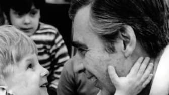 Fred Rogers and a boy.