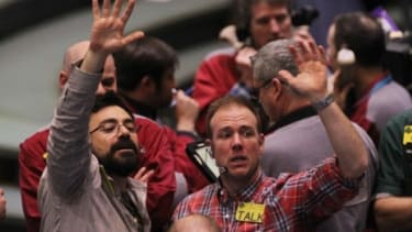 Crude oil traders in New York scramble as oil prices leap to their highest levels since September 2008 in response to the unrest in Libya.