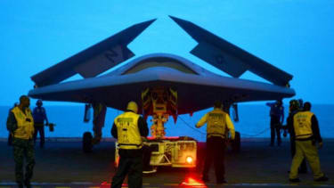 An X-47B Unmanned Combat Air System on the aircraft carrier USS George H.W. Bush in May. The Navy plans to have unmanned aircraft on each of its carriers to be used for surveillance and be ar