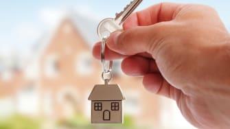 A man holding a house key.
