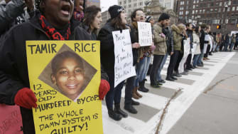 This Nov. 25, 2014, file photo, shows demonstrators blocking Public Square in Cleveland, during a protest over the police shooting of 12-year-old Tamir Rice.