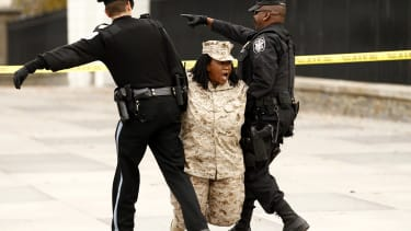 """A military veteran is arrested during a protest against """"Don't Ask Don't Tell"""" in 2010."""