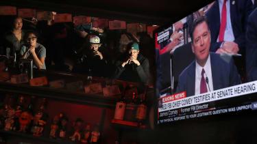 Patrons watch James Comey's testimony on TV