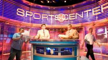 Four men work behind the backdrop inside the Sportscenter TV Studio of ESPN in Bristol Connecticut.