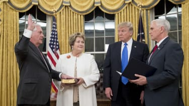 President Trump watches as Rex Tillerson is sworn is as secretary of state