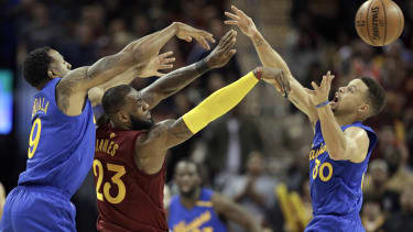 Cleveland Cavaliers' LeBron James, Golden State Warriors' Stephen Curry (30), and Warriors' Andre Iguodala.