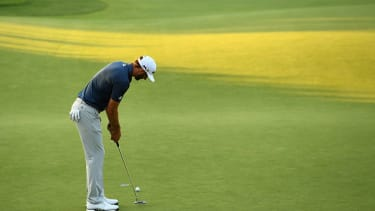 Dustin Johnson playing golf.