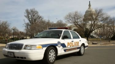 A police car sits in front of the U.S. Capitol building Friday, after FBI agents arrested a Moroccan man for allegedly plotting to attack the Capitol.