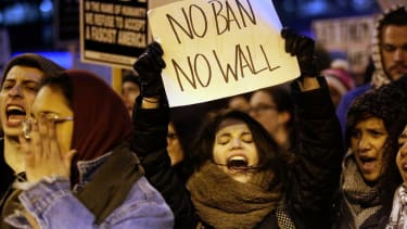 A woman protests President Trump's immigration order