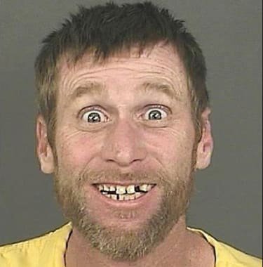 This may be the happiest mug shot of all time