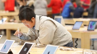A Black Friday shopper visits an Apple Store.