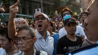 Pro-government mob destroys protest site in Hong Kong