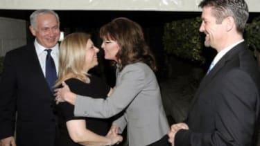 Sarah Palin greets Sarah Netanyahu and Israeli Prime Minister Benjamin Netanyahu Monday.