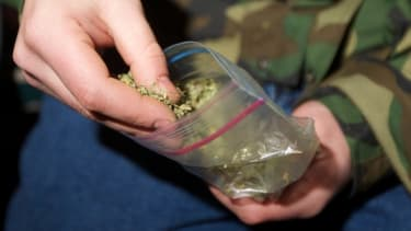 A Seattle resident prepares to smoke marijuana shortly after it became legal in the state on Dec. 6, 2012.