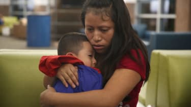 A woman, identified only as Maria, is reunited with her son Franco, 4, at the El Paso International Airport on July 26, 2018 in El Paso, Texas.