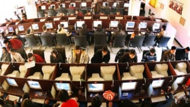 A busy internet cafe in China: 246 million internet users were added in China and India between 2007 and 2010, according to a new study quantifying the internet's worth.