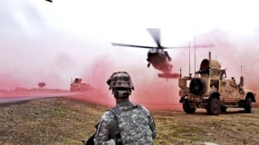 A Black Hawk helicopter lands in Afghanistan: The military is putting $4 million behind a divide mounted on to vehicles that will cause on-field hallucinations.