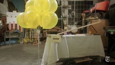 The Fed's interest rate decisions, explained through a Rube Goldberg machine