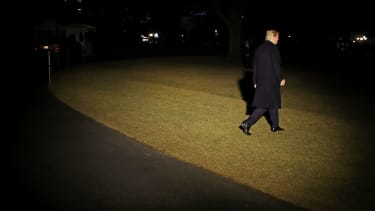 Trump leaves the White House at night