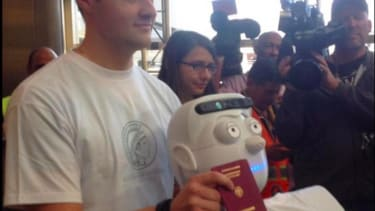 This is the first robot to buy a ticket, fly on a commercial airplane